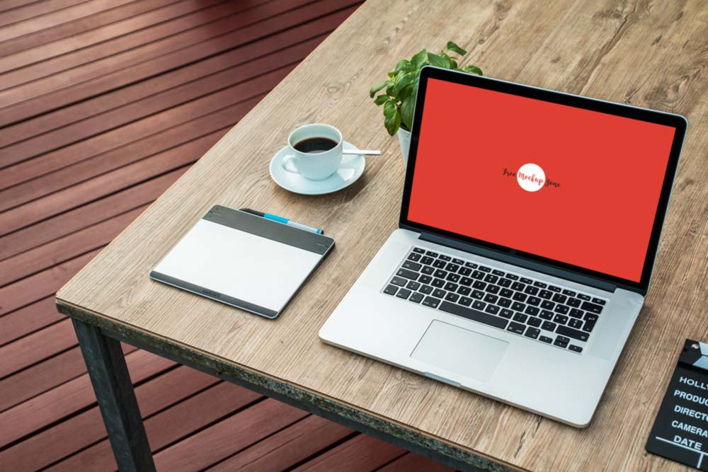 Mockup of a Laptop with a cup of tea and tablet