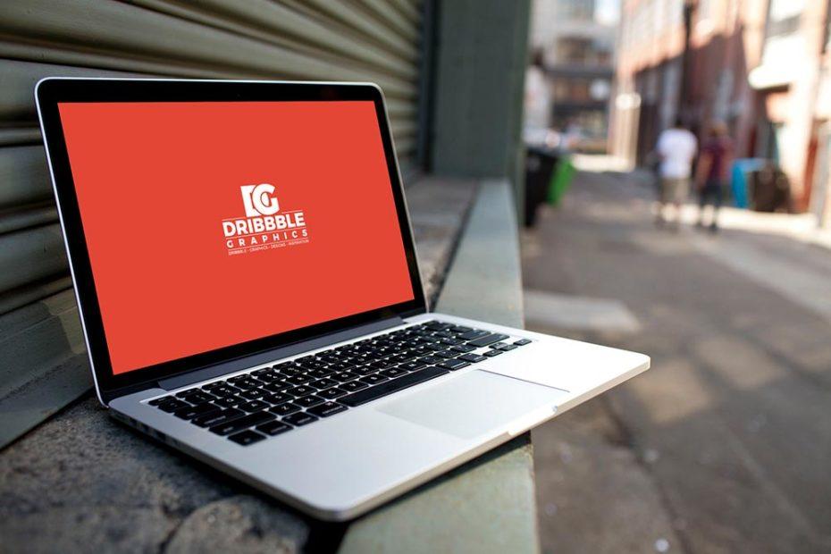 A laptop in city street mockup