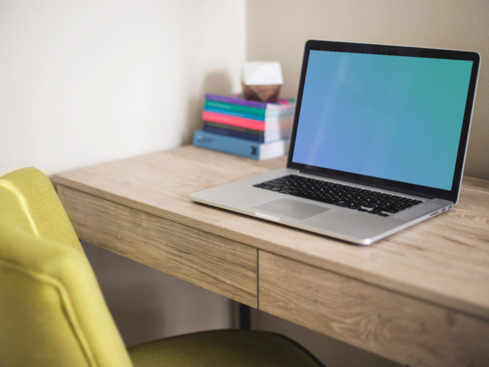 Free MacBook on Desk Mockup PSD