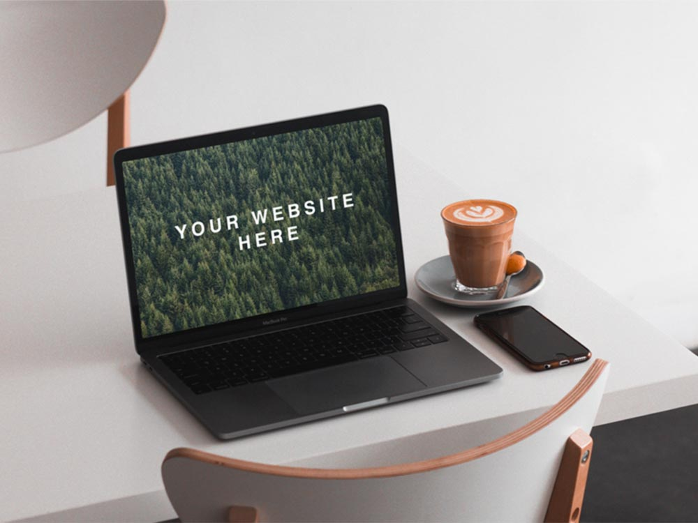 Free MacBook on Table Mockup