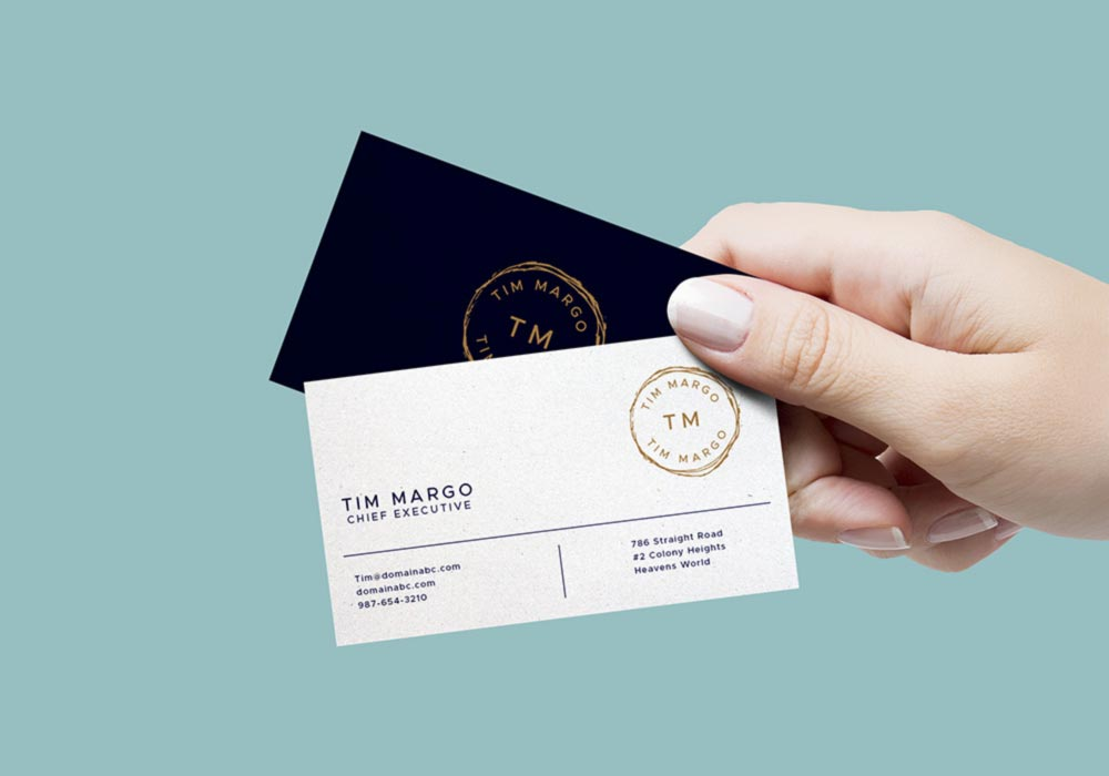 Free Hand Holding Business Card Mockup PSD