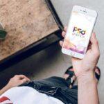 Free Female Holding iPhone Mockup