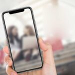 Free Simple iPhone X in Hand Mockup